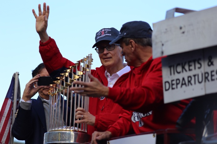 Red Sox Owner John Henry and the World Series Trophy Photo by Ben Thomas @bdthomas
