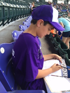 Scoring the game in the purple seats